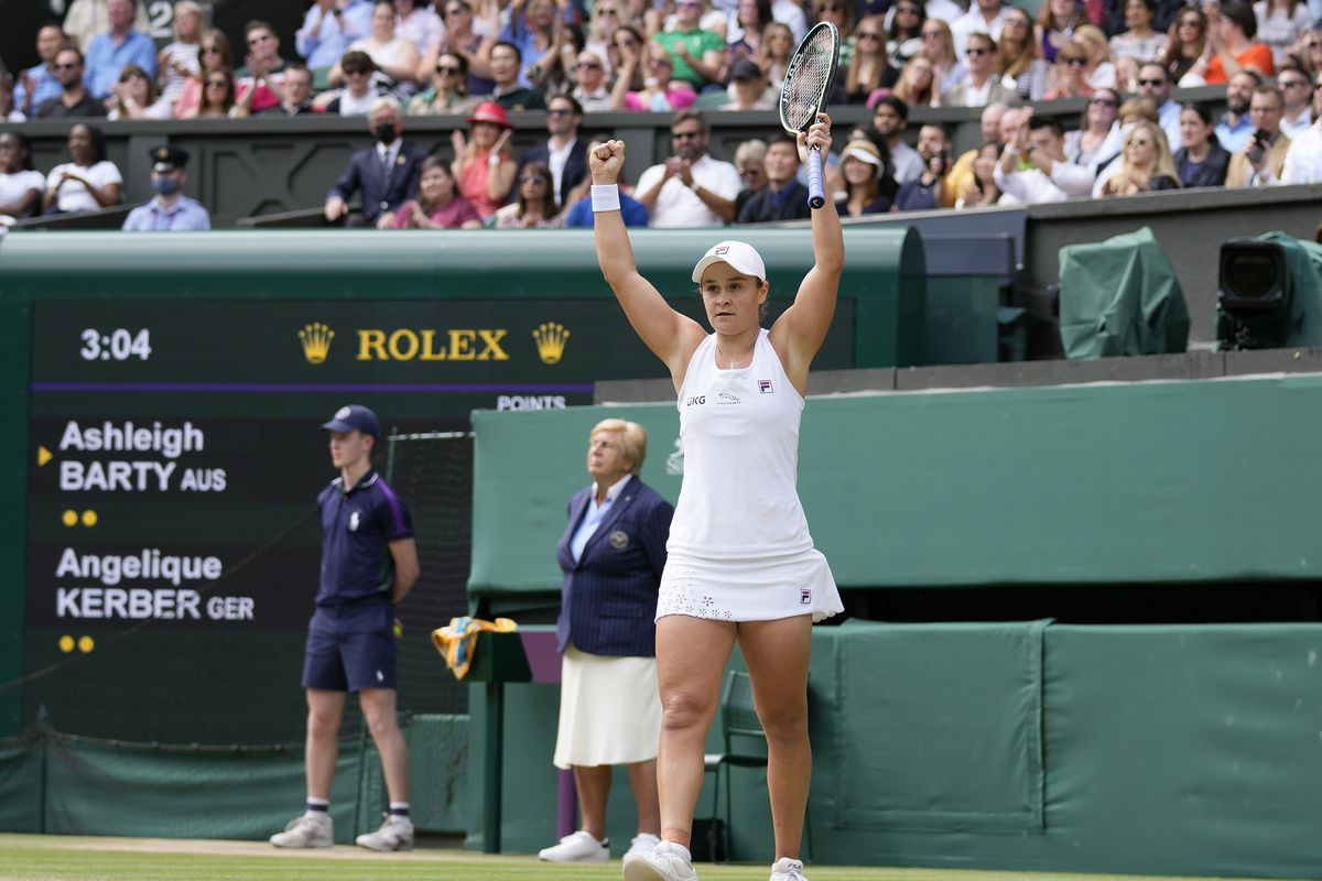 Ash Barty celebrates after defeating Angelique Kerber to reach the women's final at Wimbledon.