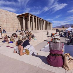 """Extras sit on steps during filming of a faith-based streaming series on the life of Jesus Christ called """"The Chosen"""" at The Church of Jesus Christ of Latter-day Saints' Jerusalem set in Goshen, Utah County, on Monday, Oct. 19, 2020."""