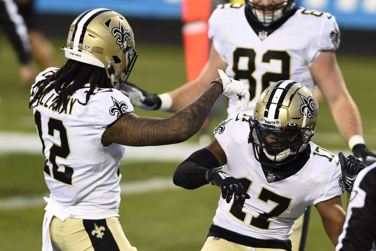 New Orleans Saints wide receiver Emmanuel Sanders (17) celebrates with wide receiver Marquez Callaway (12) after catching a touchdown in the second quarter at Bank of America Stadium.