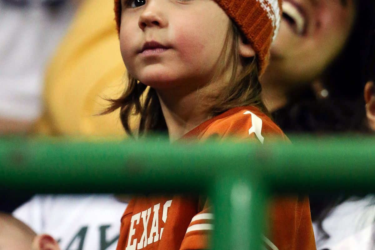 This little girl is ready for the game. Are you?