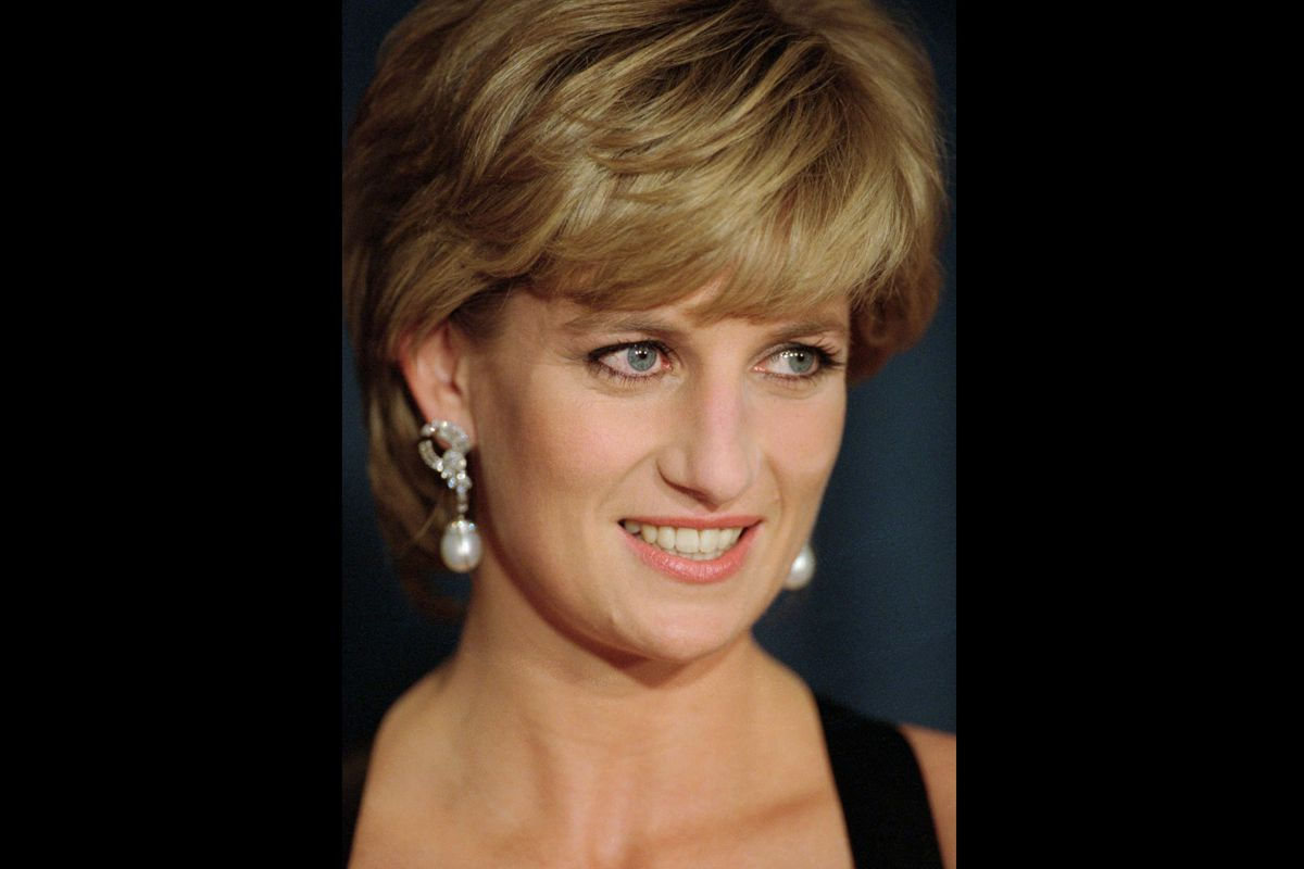 """In this Dec. 11, 1995 file photo, Diana, Princess of Wales, smiles at the United Cerebral Palsy's annual dinner at the New York Hilton. An investigation has found that a BBC journalist used """"deceitful behavior"""" to secure an explosive interview with Princess Diana in 1995, in a """"serious breach"""" of the broadcaster's guidelines."""