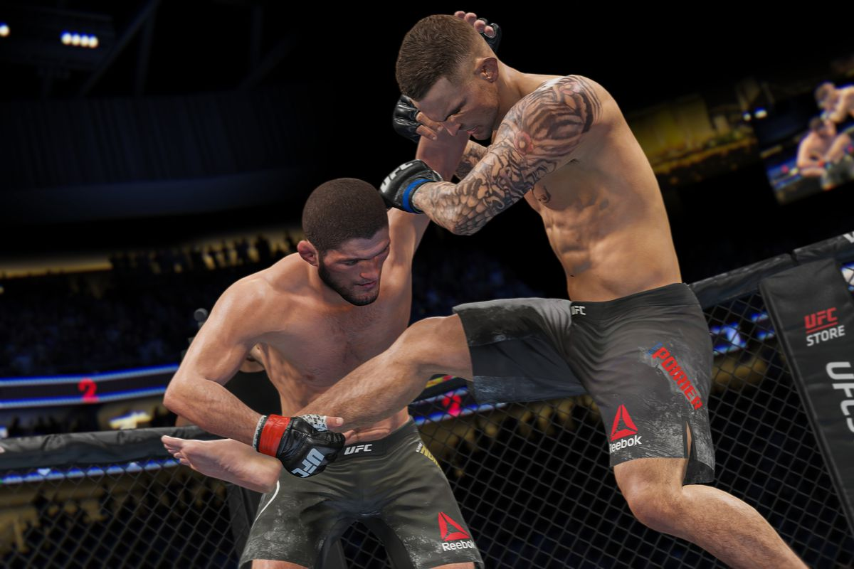 Two tattooed mixed-martial arts fighters grab at each other's limbs in a UFC 4 fight