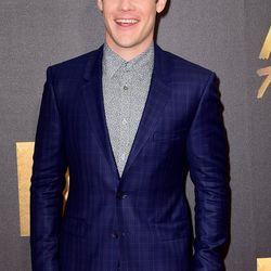 Adam Devine in a blue plaid suit.