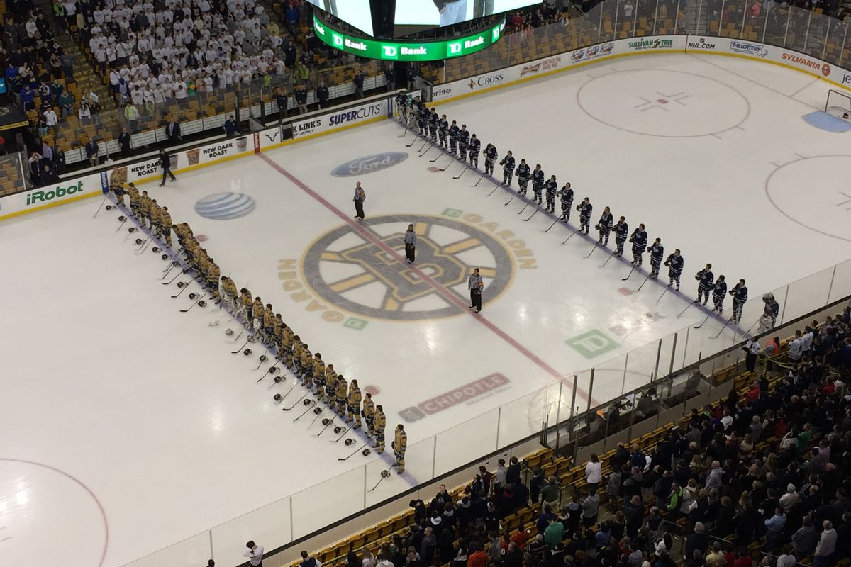 Malden Catholic and St. John's Prep players lined up for the national anthem prior to Sunday's Super 8 Final at the TD Garden.