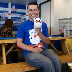 """Carlos Wong, the man responsible for LA's first cat cafe. He tells us that it's all """"been just a concept in my head so far; I'd seen it in Japan [when] I lived there, [...] but now that it's actually happening [in the States], it's pretty exciting."""" Kicks"""