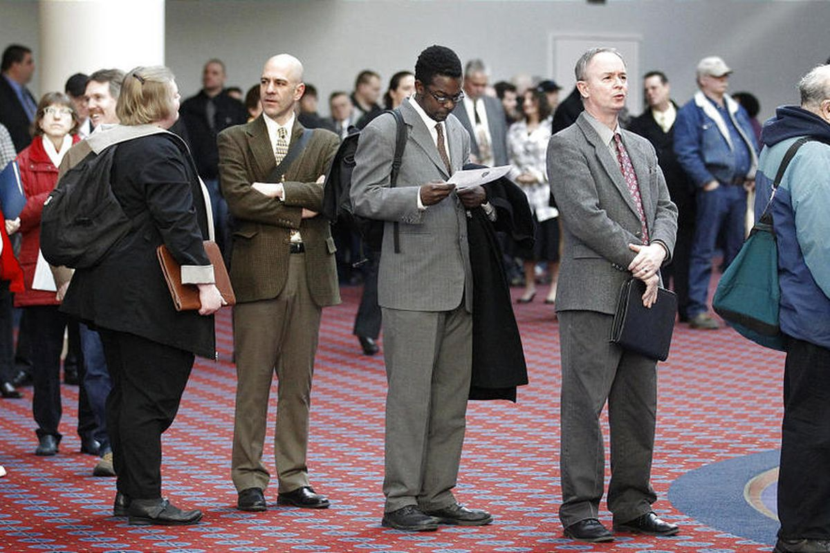 FILE - In this March 7, 2012, file photo shows job seekers standing line during the Career Expo job fair, in Portland, Ore.  Employers pulled back sharply on hiring last month, a reminder that the U.S. economy may not be growing fast enough to sustain rob