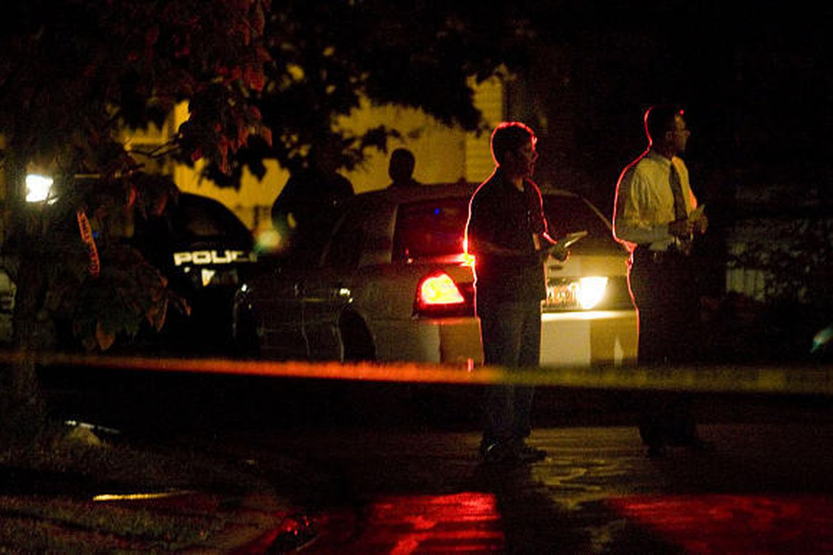 Police investigate the area in the Majestic Oaks community of Taylorsville after a man was shot and killed at his home Sunday. The man's wife was also injured in the incident.