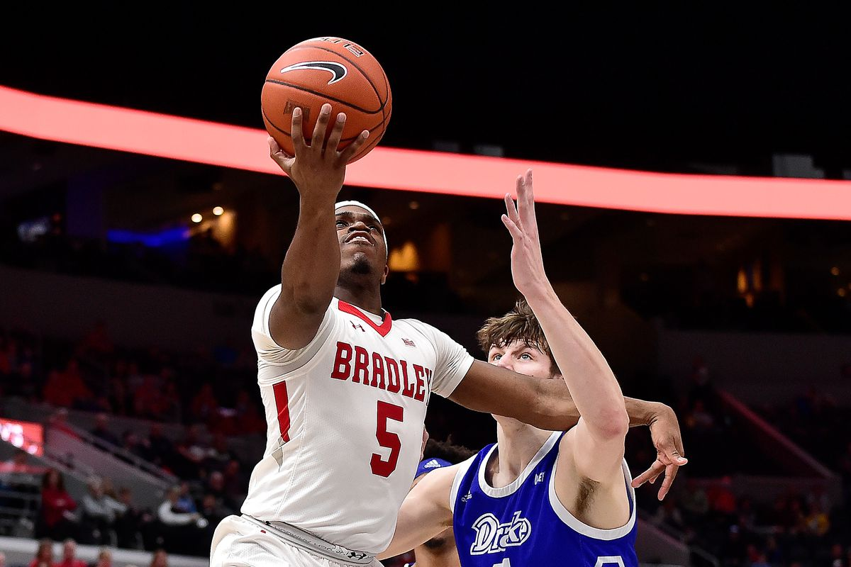 Bradley Braves guard Darrell Brown shoots a lay up as Drake Bulldogs forward Liam Robbins defends during the second half at Enterprise Center.