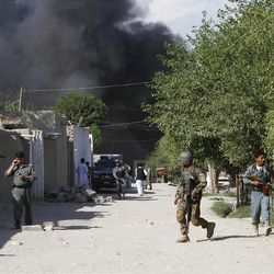 Afghan security forces are seen after a suicide attack on the U.S.-led provincial reconstruction team (PRT) compound in the Behsood district of Jalalabad, east of Kabul Afghanistan, on Sunday, April 15, 15 2012. The Taliban launched a series of coordinated attacks on at least seven sites across the Afghan capital on Sunday, targeting NATO headquarters, the parliament and diplomatic residences. Militants also launched near-simultaneous assaults in three other eastern cities. (AP Phot/Rahmat Gul)