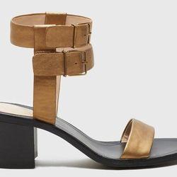 "<b>Pour la Victorie</b> Dagney in Brass, <a href=""http://www.pourlavictoire.com/catalog/product/view/id/983/s/dagney/category/3/?color=63"">$250</a>"