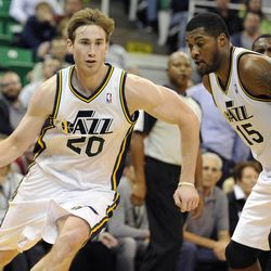 Utah Jazz small forward Gordon Hayward (20) follows the screen of teammate Utah Jazz power forward Derrick Favors (15) in the second half of a game at the Energy Solutions Arena on Wednesday, October 16, 2013.