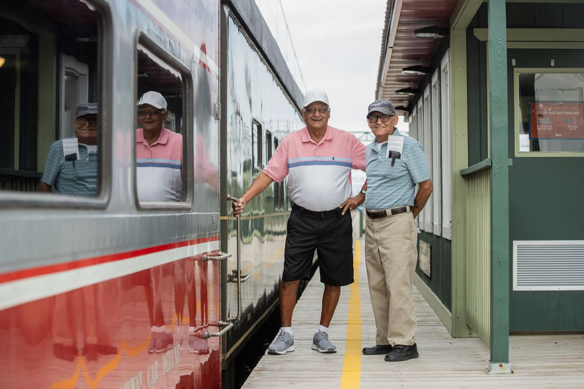 Brothers Alfonso (left) and Ray Quiroz, who both worked for the Pullman Palace Car Co., are shown with a train car manufactured by the company. They attended a media preview of the Pullman National Monument on Friday, Sept. 3, 2021.