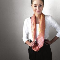 For your sweet mom, a scarf that'll make her cheeks glow. Pink Infinity Scarf in Gold Herringbone, $38, Argaman & Defiance