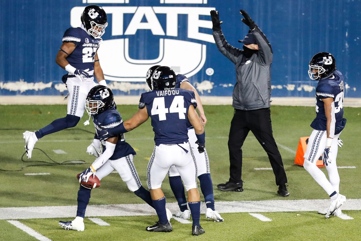 Utah State Aggies players celebrate after Utah State Aggies cornerback Michael Anyanwu (22) returns a fumble for a touchdown during an NCAA football game at Maverik Stadium in Logan on Thursday, Nov. 26, 2020. The play was then called back due to an incomplete pass.