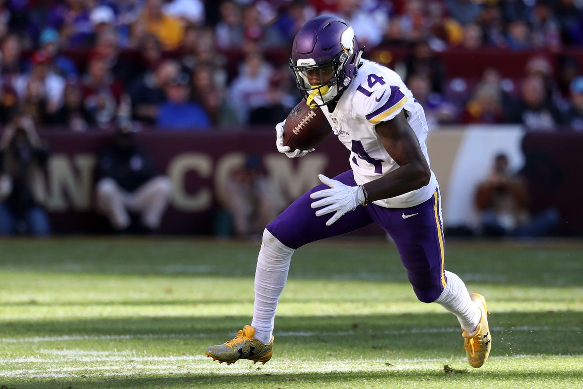 Minnesota Vikings wide receiver Stefon Diggs carries the ball
