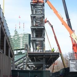 2:57 p.m. Girder being lifted to the top of the right field video board structure -