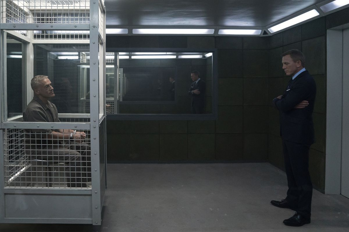 blofeld and james bond stand in a prison in norway in no time to die