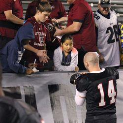 Connor Shaw signs autographs for South Carolina fans.
