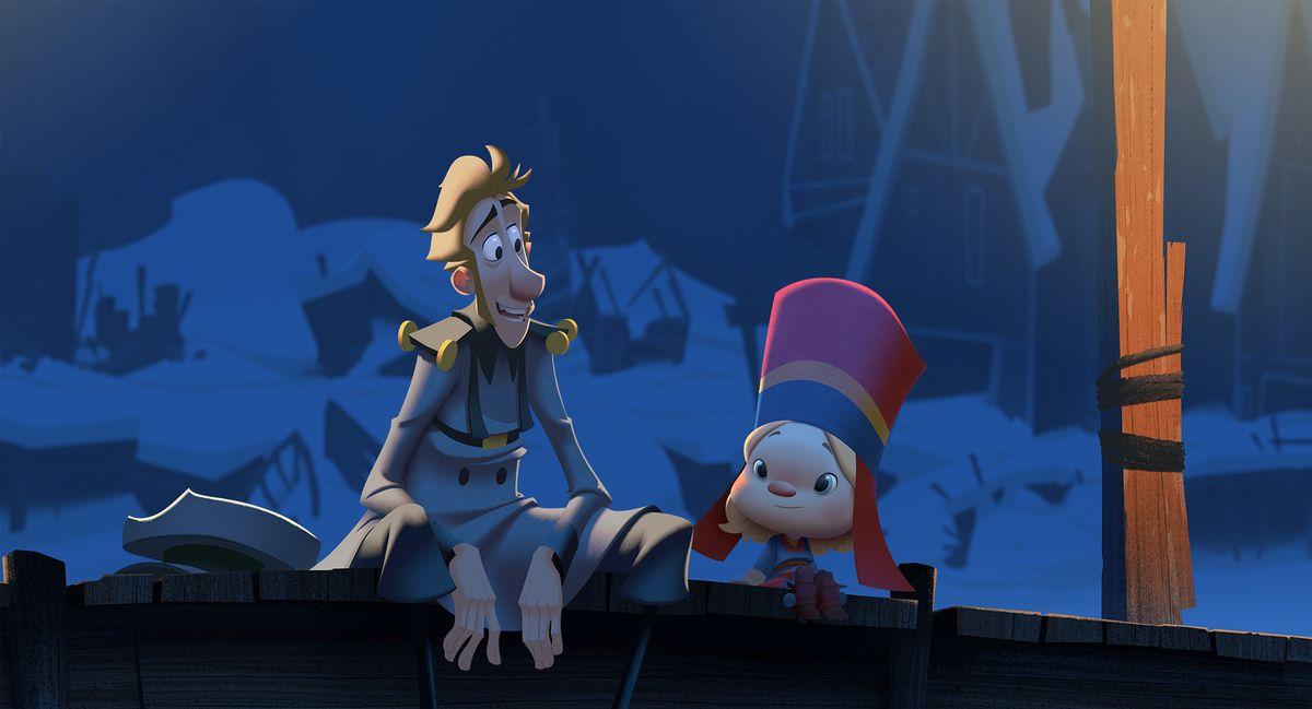 Jesper sits with Margu, a little Sámi girl