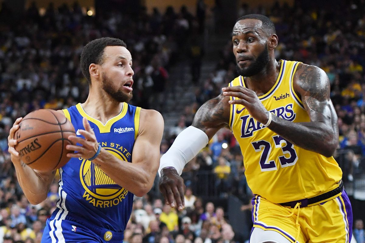 Stephen Curry of the Golden State Warriors drives against LeBron James of the Los Angeles Lakers during their preseason game at T-Mobile Arena on October 10, 2018 in Las Vegas, Nevada. The Lakers defeated the Warriors 123-113.