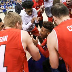 Utah Utes players prepare to take the court against the Brigham Young Cougars at the Marriott Center in Provo on Saturday, Dec. 16, 2017.