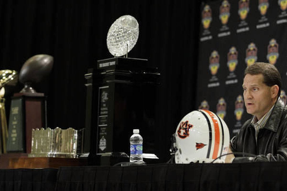 Auburn head coach Gene Chizik answers questions during a news conference after the BCS National Championship NCAA college football game, Tuesday, Jan. 11, 2011, in Scottsdale, Ariz. Auburn beat Oregon 22-19 to capture the championship.