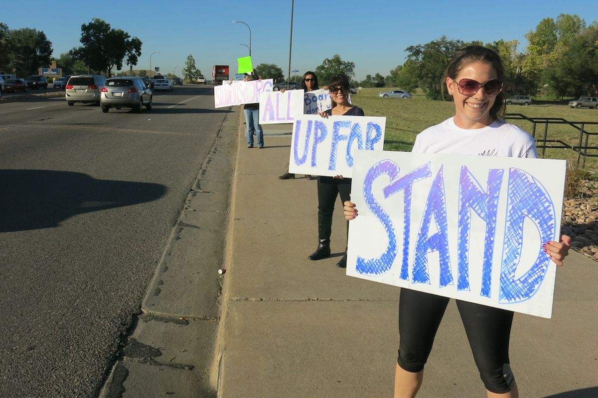 Jeffco Public Schools teacher Audrey Truesdale rallied with more than 100 other educators, parents, and students Friday evening to raise awareness for their concerns about the county's school board majority.
