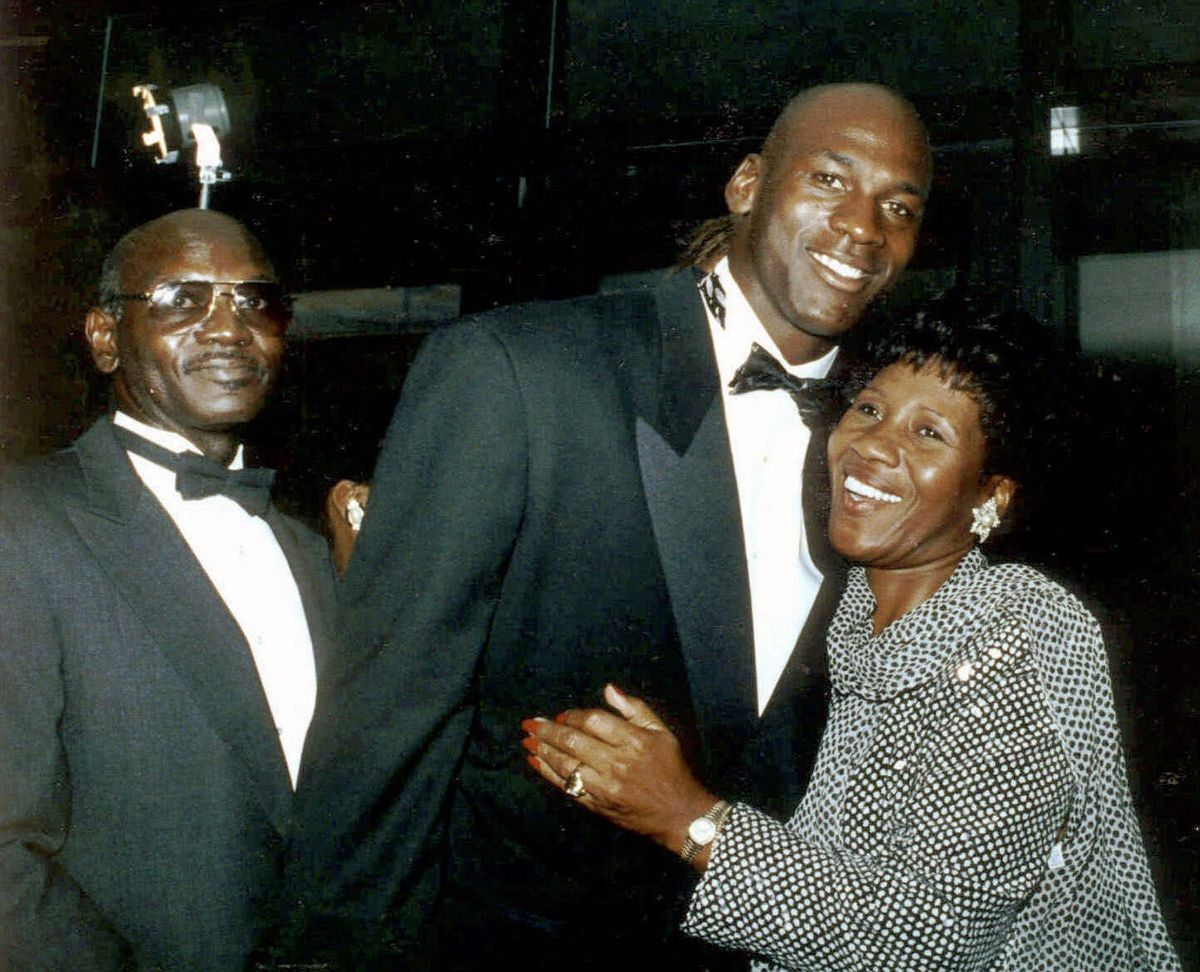 Michael Jordan hugs his mother, Delores, in this Sept. 15, 1990, file photo as his father, James, looks on, during a gala dinner for the Michael Jordan Foundation at the Hotel Nikko in Chicago.