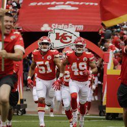 Kansas City Chiefs linebacker Frank Zombo (51) and defensive back Daniel Sorensen (49) run onto the field before an NFL football game against the Philadelphia Eagles in Kansas City, Mo., Sunday, Sept. 17, 2017. (AP Photo/Charlie Riedel)