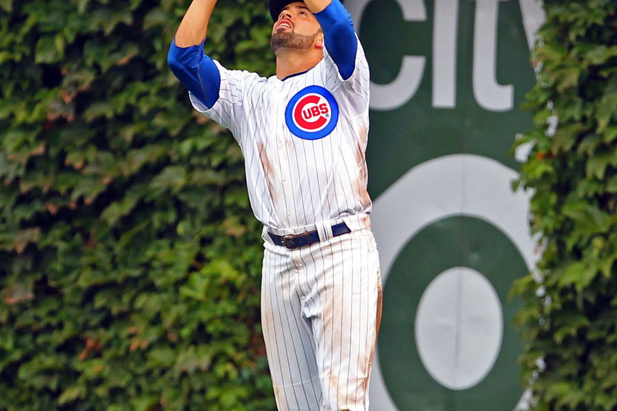 Chicago, IL, USA; Chicago Cubs right fielder David DeJesus catches a fly ball off the bat of San Francisco Giants third baseman Marco Scutaro at Wrigley Field. Credit: Dennis Wierzbicki-US PRESSWIRE