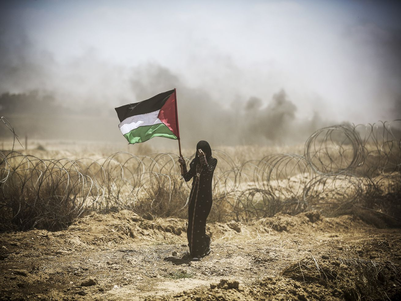 Palestinians take part in a protest organized to mark the 70th anniversary of the Nakba, also known as the Day of the Catastrophe, in 1948, and against the US decision to relocate their embassy from Tel Aviv to Jerusalem, on May 14, 2018. (Gaza City, Gaza)