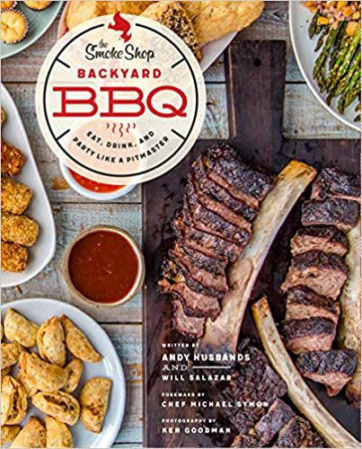 A cookbook cover features an overhead shot of a picnic table covered with barbecue