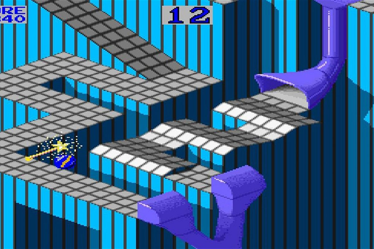 the gridded, isometric playing course of Marble Madness; a magic wand respawns the marble for a few seconds after the game's clock has run out.