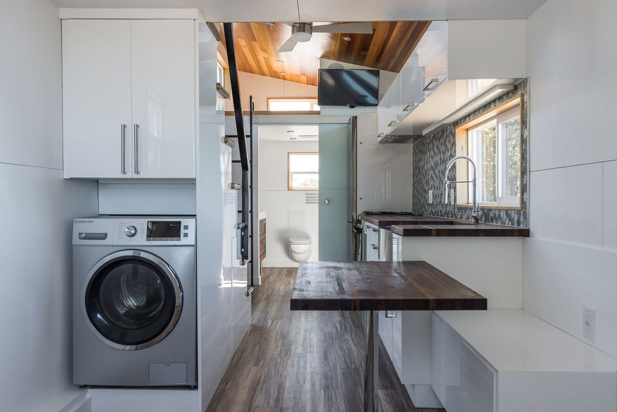 home floor design. The walls and cabinets are white  while the ceiling floors stairs countertop wood New tiny house features contemporary design details Curbed