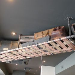 A luggage rack hangs from the ceiling.