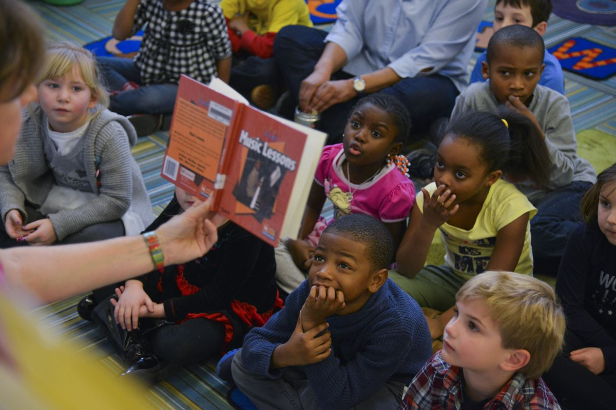 A librarian reads stories to kindergarten students at a public elementary school in Washington, D.C. in February 2015.