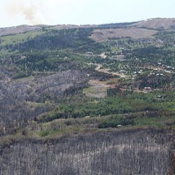 This Tuesday, Jan. 27, 2017, photo taken by Tim Roide, Incident Commander, shows an aerial view of burnout areas around Brian Head, Utah. In Utah, firefighters hope Wednesday, June 28, 2017, to douse areas with intense blazes at the Utah fire's southern end so residents can return to homes in the town of Brian Head. Homes there have been evacuated since June 17 since authorities said the fire was started by someone using a torch tool to burn weeds on private land.