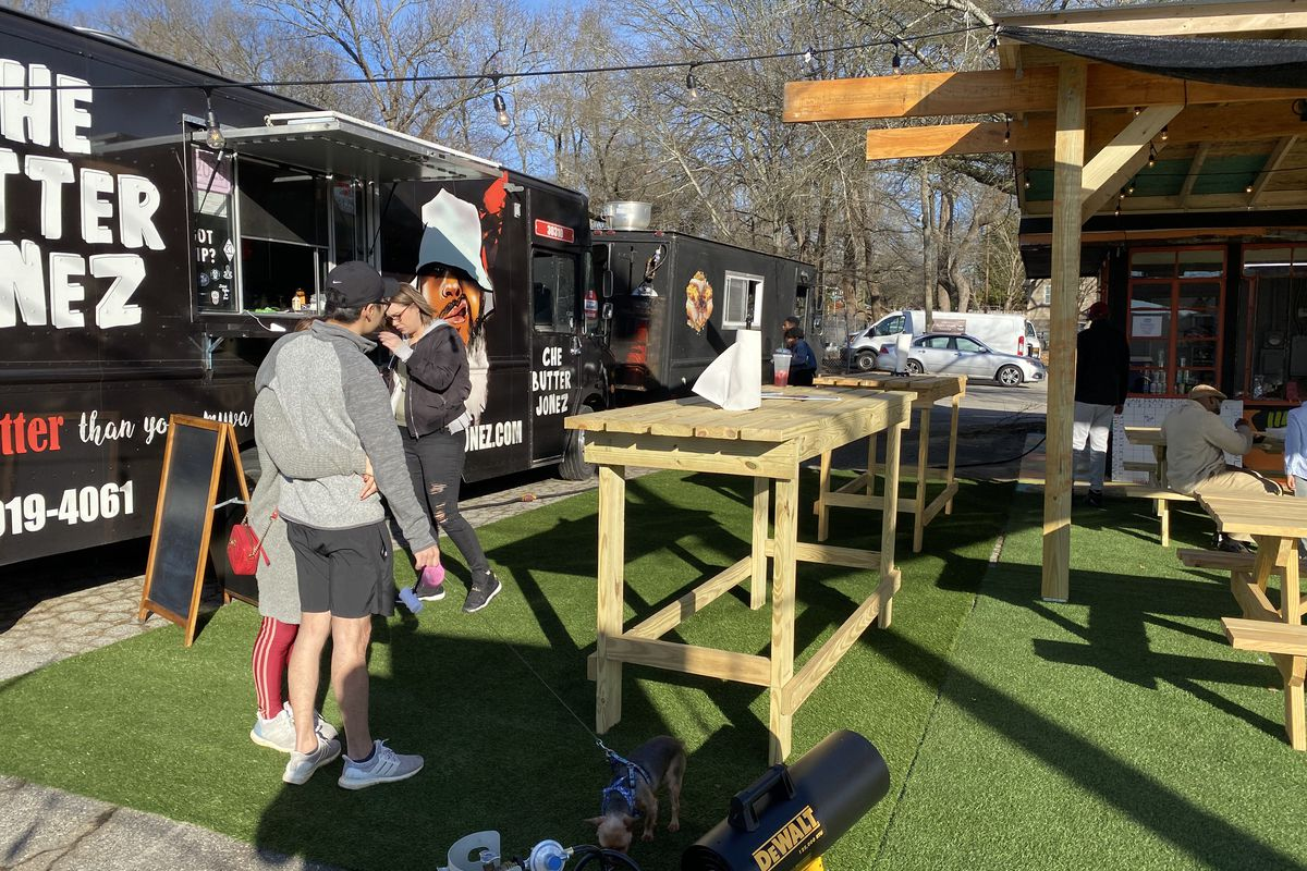 Customers ordering from the Che Butter Jonez food truck on Sylvan Road at Triton Yards in Southwest Atlanta
