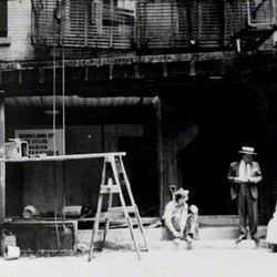 """During renovations of the original Lombardi's, circa 1930s, Gennaro's wife Filomena sat outside and let people know that Lombardi's was still open for business. <span class=""""credit""""> <a href=""""http://www.firstpizza.com/home.html/"""">[Lombardi's Original Pizz"""