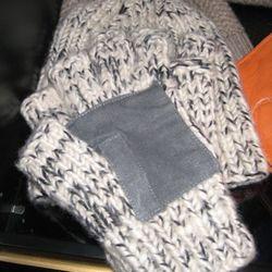 Raif Adelberg cashmere beanie, $325<br />Raif Adelberg cashmere fingerless gloves, $390