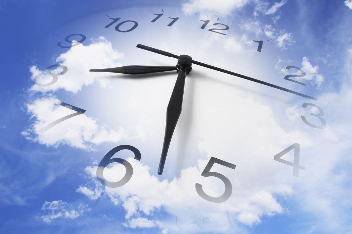 Clocks and cloudy sky.