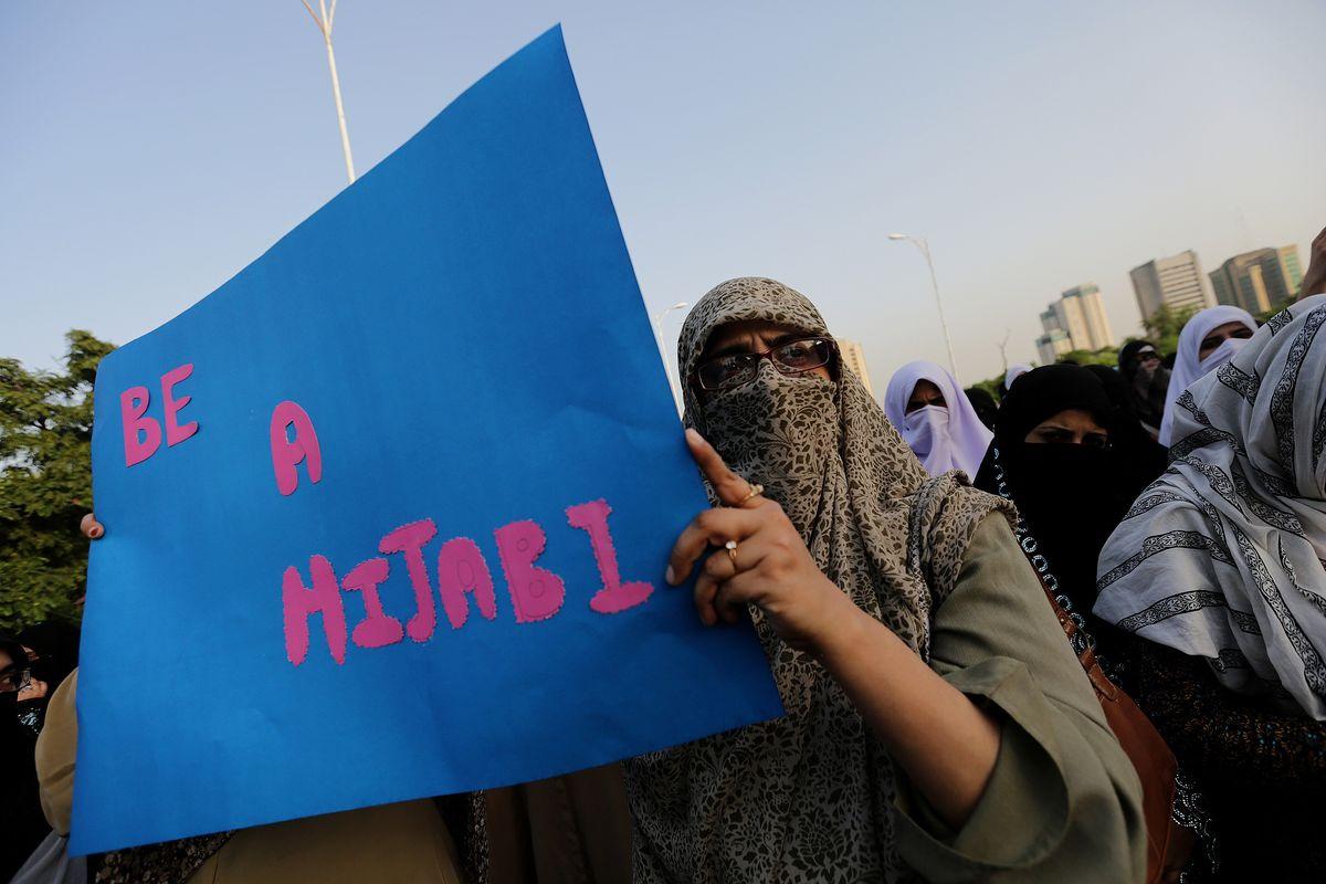"""""""Be a hijabi"""" sign."""