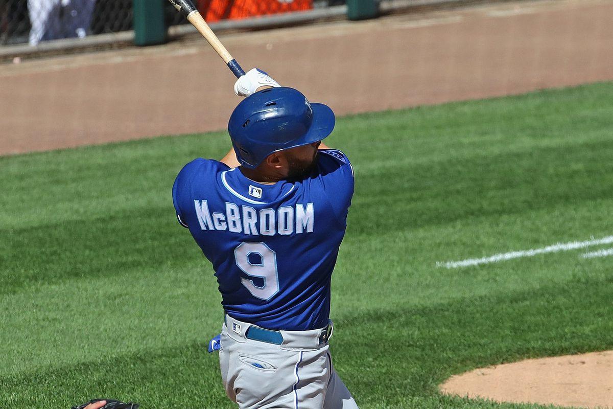 Ryan McBroom follows through after hitting his third pinch-hit home run of the season.