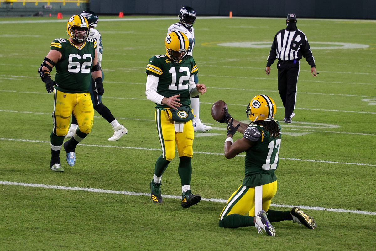 Davante Adams of the Green Bay Packers celebrates with teammate Aaron Rodgers following a nine-yard touchdown reception during the third quarter of their game against the Philadelphia Eagles at Lambeau Field on December 06, 2020 in Green Bay, Wisconsin.