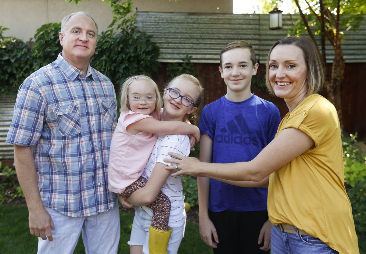 Jordan, Tori, Alexa, Jackson and Amanda Longwell are photographed at their home in Salt Lake City on Wednesday, July 29, 2020. The Longwells have decided as a family to return to remote learning this fall due to risks to Tori, who has Down syndrome, but also to the entire family.