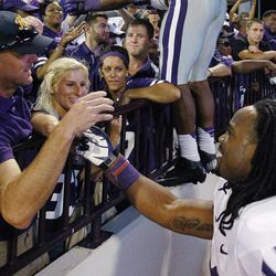 Kansas State running back John Hubert (33) celebrates with fans following a 24-19 victory over Oklahoma in an NCAA college football game in Norman, Okla., Saturday, Sept. 22, 2012.