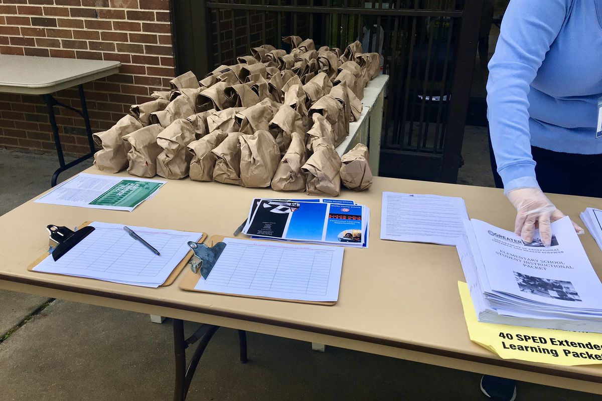 The YMCA took over food distribution for students as district staff prepared paper learning packets for pickup.