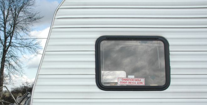 """Trailer with sticker that says """"Not to be used for housing"""""""