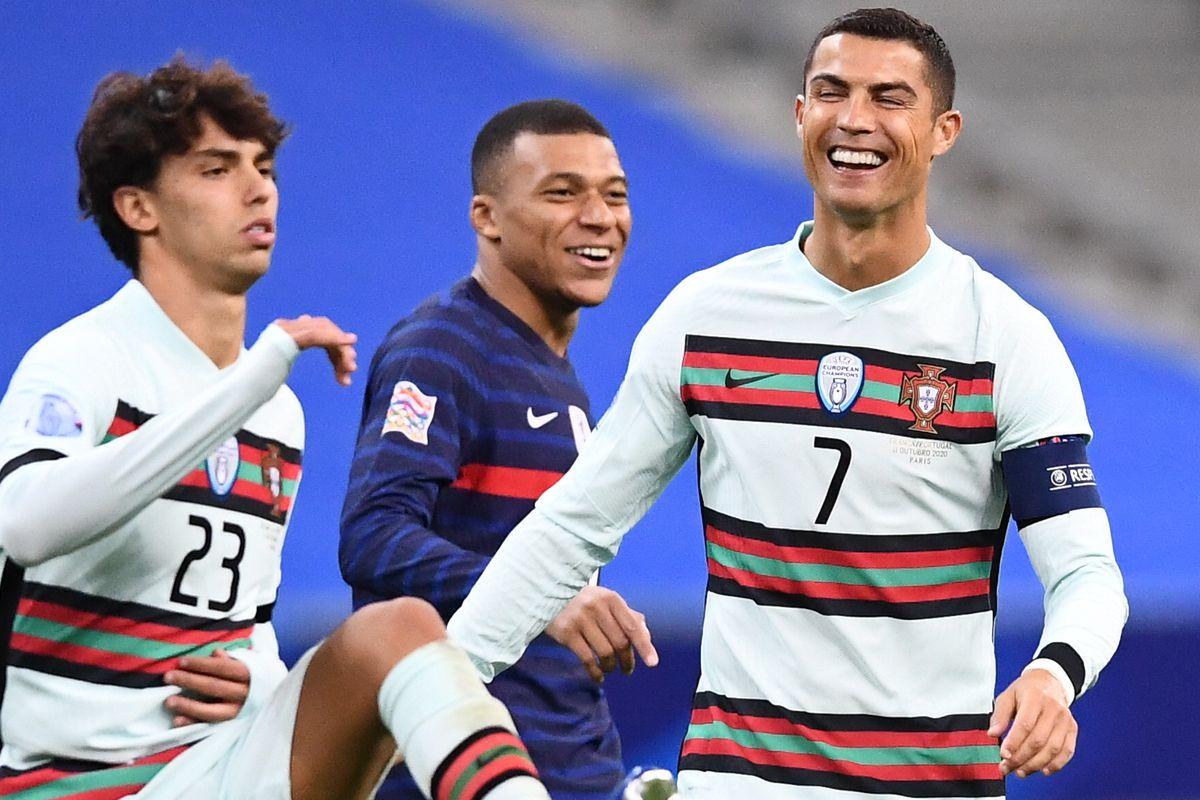 Kylian Mbappe shares a laugh with Portugal's forward Cristiano Ronaldo - France vs Portugal - Euro 2020