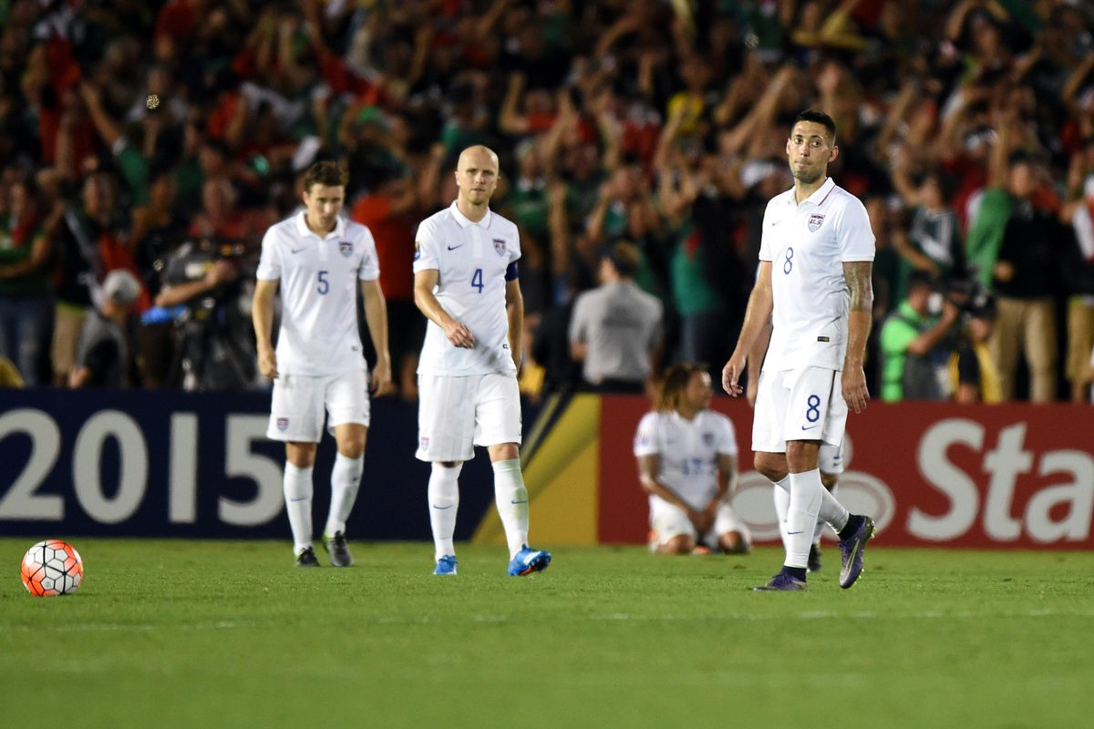 Matt Besler (5), Michael Bradley (4) and Clint Dempsey react after the US fell to Mexico 3-2 in extra time.